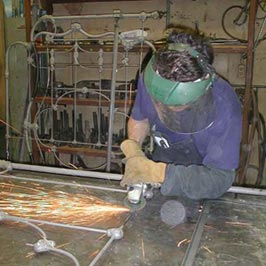 Cathouse Employee grinding welds for smooth transistion