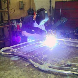 Cathouse employees welding new metal in a conversion process